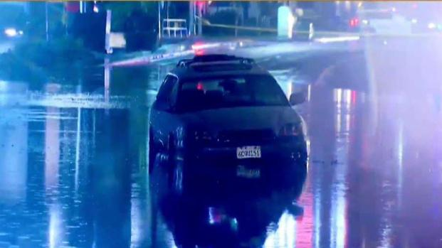 Car Partially Submerged in San Marcos After Flooding