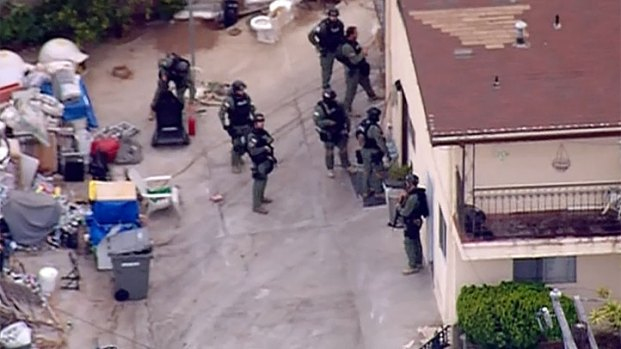[DGO] Federal Agents Surround National City Home