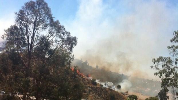 Fire Sparks on Hillside Off SR-125
