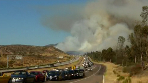 IMAGES: Brush Fire Burns Off SR-52