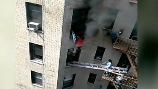 [NATL-NY] Dramatic Rescue: Hero Saves Man from Burning Building