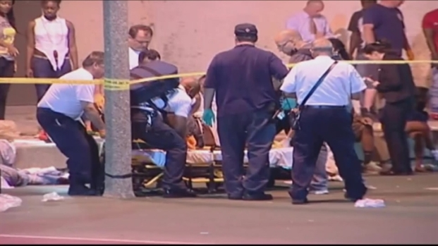 [AP] Raw Video: 13 Injured in Chicago Park Shooting