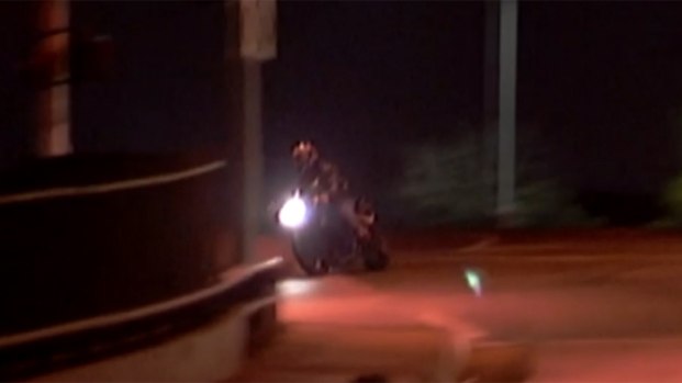 [DGO] RAW: Cop Jumps to Stop Moving Motorcyclist