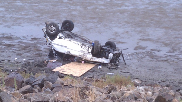 Car Flipped Into SD River