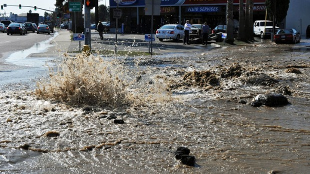 [gallery]Water Floods Businesses, Streets in Midway
