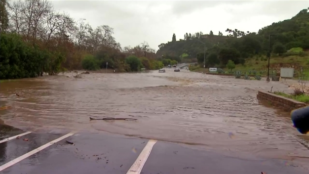 Flood Water Forms River Rushing Down Carroll Canyon Road