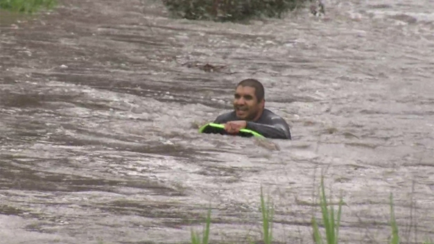 Man Boogie Boards in Barona Flood Waters