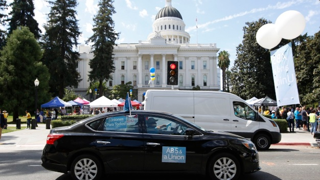 Newsom Signs Law on Protections for Uber Drivers, Others