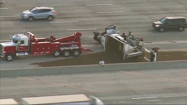 Overturned Truck Spills Sand Cement on NB I-5