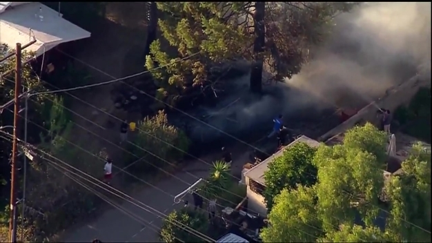 Neighbors Jump in to Help Put Out Fire in Spring Valley