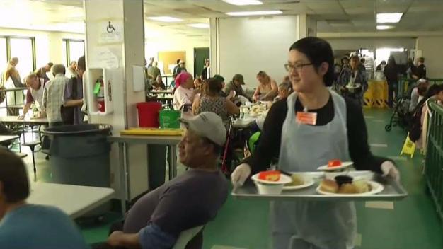 Volunteers at Father Joe's Serve Thanksgiving Dinner