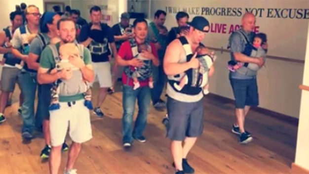 Watch: Dads Dance While Wearing Babies