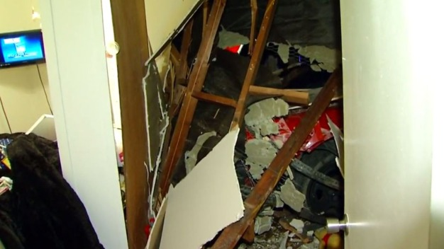 Driver Crashes into Sleeping Woman's Room in Police Chase