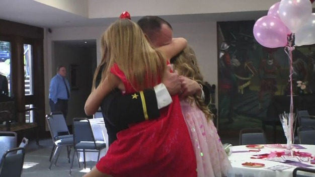 Military Dad Surprises Daughters at Daddy/Daughter Dance
