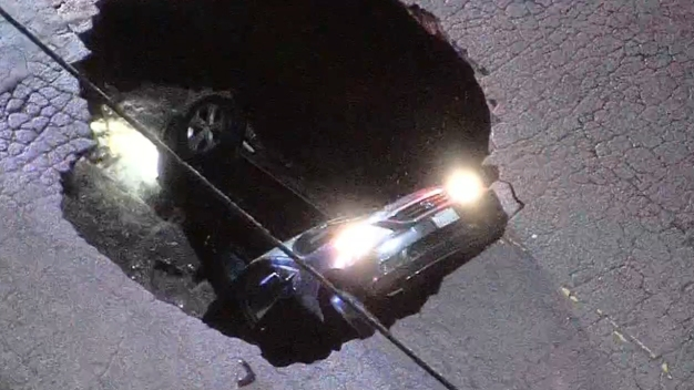 Sinkhole Swallows Cars in Deadly California Storm