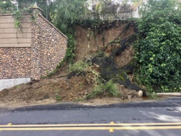 Kensington woman wants city to fix hill slide behind her home