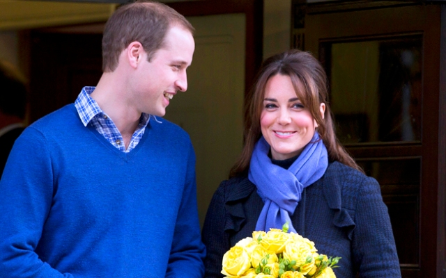 Britain's Prince William stands next to his wife Kate, Duchess of Cambridge as she leaves the King Edward VII hospital in central London, Thursday, Dec. 6, 2012. Prince William and his wife Kate are expecting their first child, and the Duchess of Cambridge was admitted to hospital suffering from a severe form of morning sickness in the early stages of her pregnancy.  (AP Photo/Alastair Grant)