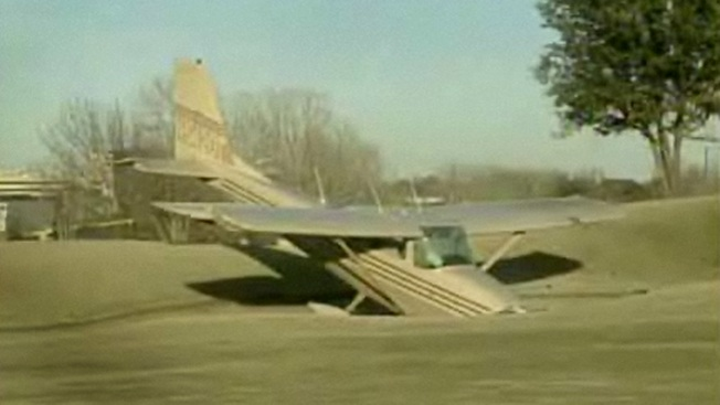 Bogey on the Fourth, Plane Lands on Golf Course