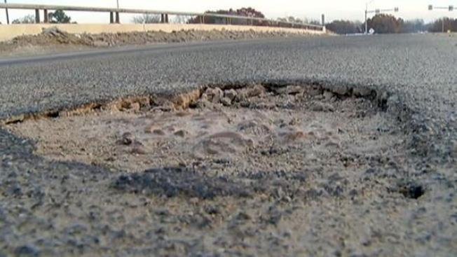 Vigilante Roadwork: Woman Fed Up With Chicago's Potholes Will Fix Them Herself