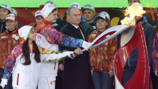 Putin Lights Olympic Flame for Sochi on Red Square