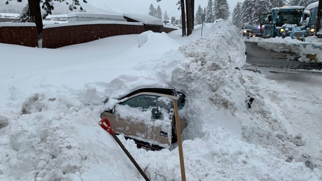 Snowplow Bumps Into Snow-Covered Car, Finds Woman OK Inside