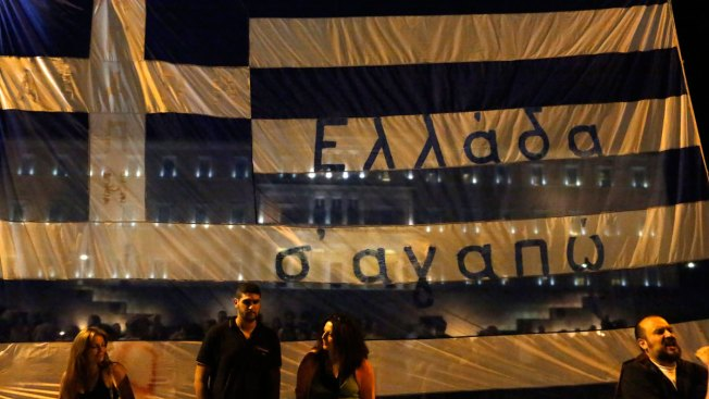 Greek Parliament Passes Austerity Bill Needed to Open Bailout Negotiations