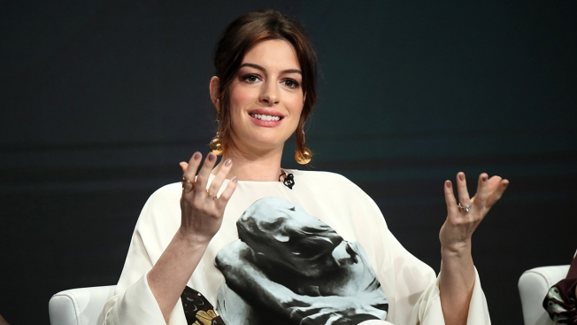 Anne Hathaway Steps Out After Pregnancy Announcement and Talks 'Mommy Brain'