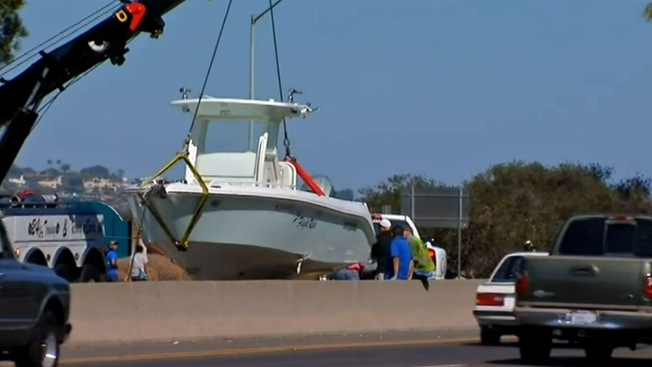 Boat Falls Off Trailer, Causes Traffic Jam