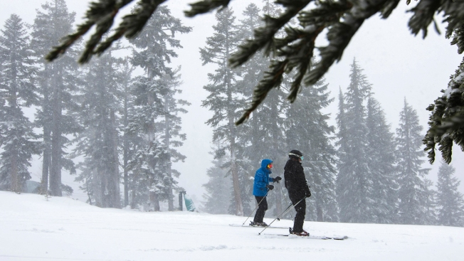 Rain, Snow, Wind Batter West While Record Warmth Lingers in East