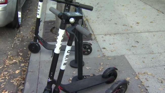 Two Men Crash on Electric Scooters Near Buca di Beppo Downtown