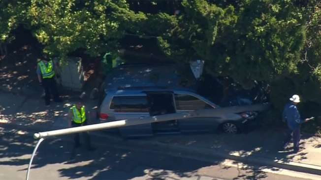 Driver Plows Into Light Pole