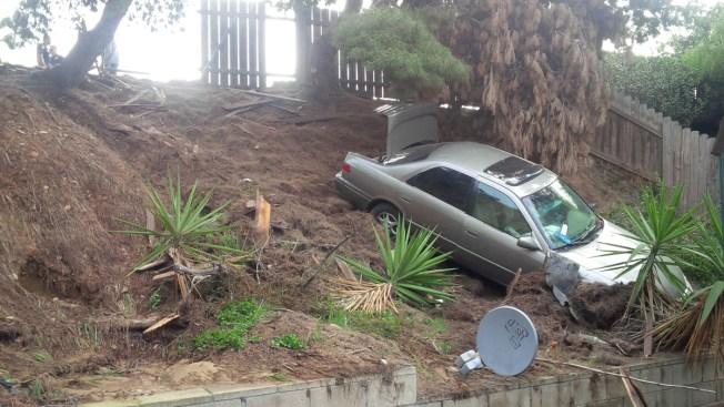 Car Crashes Through Fence, Down Backyard Slope