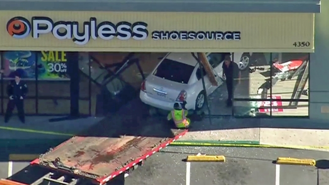 Car Drives Into Shoe Store