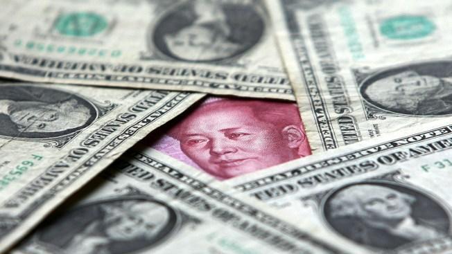 Lashing Back, China Lets Yuan Drop, Halts US Farm Purchases
