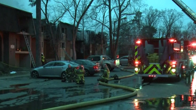 Rescue crews catch child thrown to safety during apartment fire