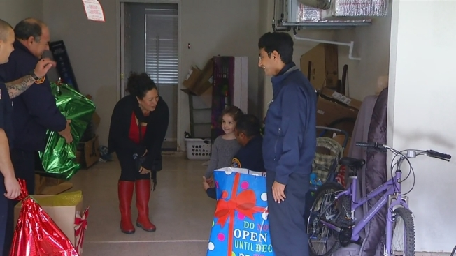 firefighters deliver gifts to mount hope house fire victims