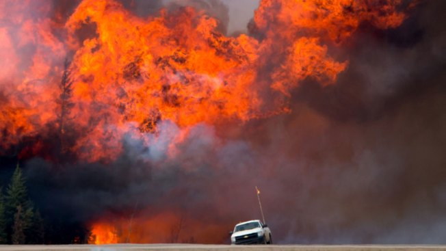 Cooler Temperatures, Rain Give Firefighters Hope in Canada
