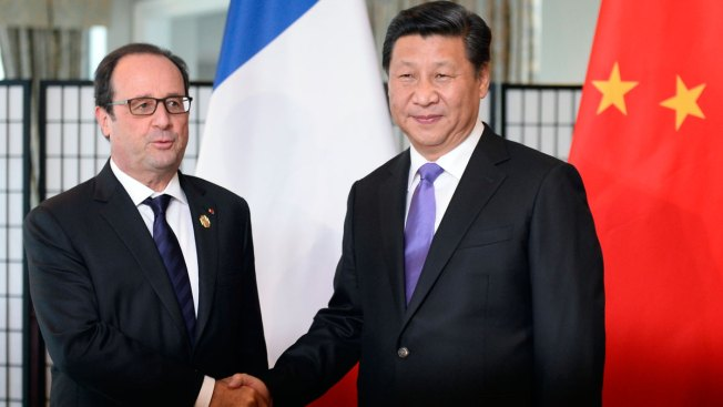French President Travels to China to Discuss Climate Change