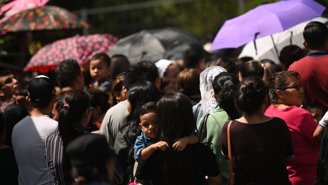 Drowned Father and Daughter Mourned at El Salvador Cemetery