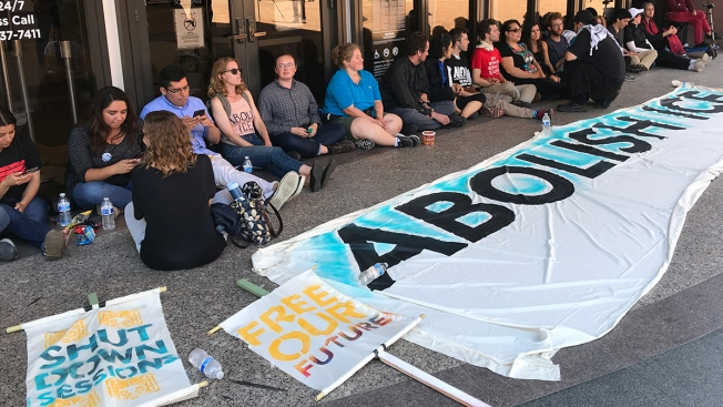 Images: Protesters Lock Arms Outside Federal Building in San Diego