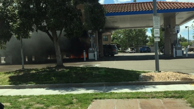 Hazmat Officials Clean Up After Car Fire Spreads to Gas Station