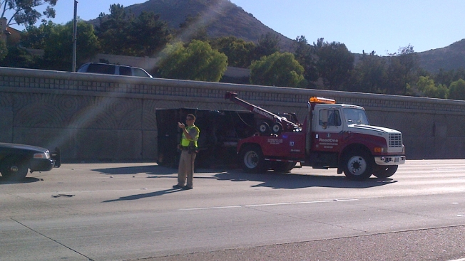 UPS Truck Rolls Onto Side on Freeway