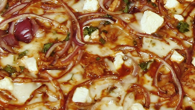 Officials: Pizza Shop Owner Tried to Recruit Teen for Prostitution