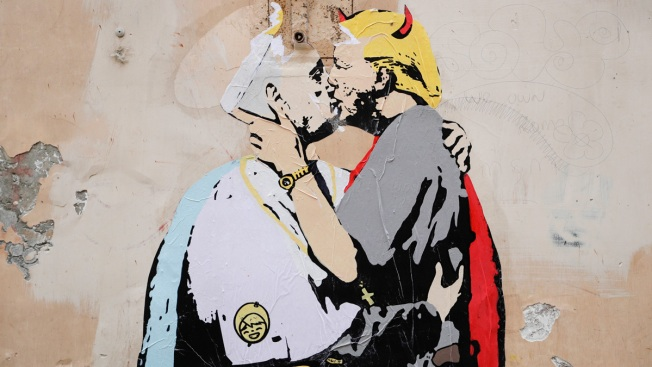 Mural on Roman wall depicts Pope embracing Trump