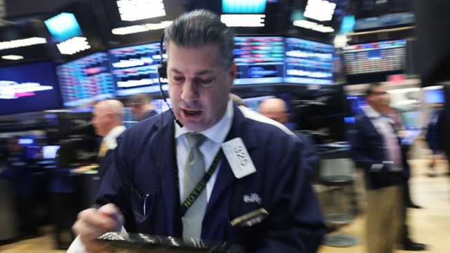 Dow industrials flirt with worst daily tumble in 8 months
