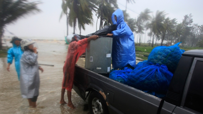 Tropical Storm's Rain, Surging Seas Strike Thai Beaches