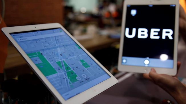 Uber Passenger Who Lost Legs in Crash Sues