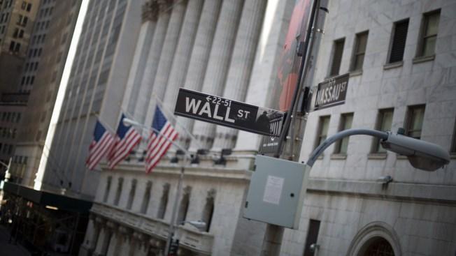 Dow Closes at Record High as Investors Ride Trump Wave