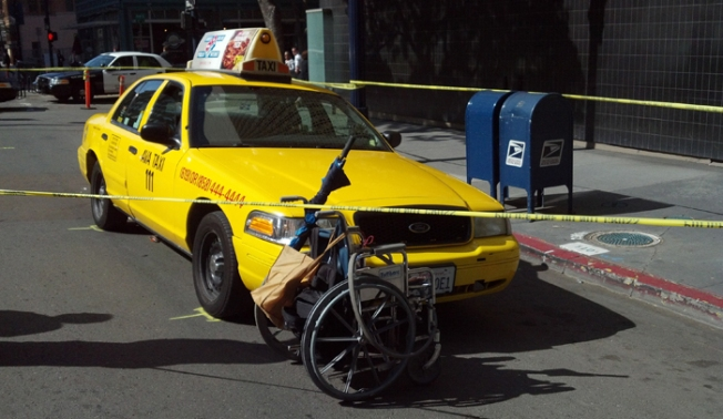 Taxi Strikes Person in Wheelchair