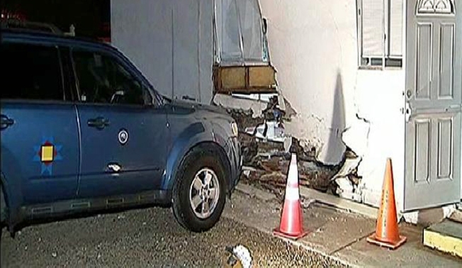 SUV Crashes Into School
